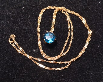 RCI 14k yellow gold with blue sapphire necklace