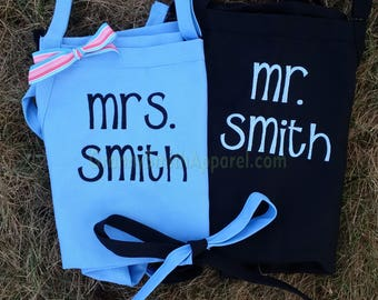 "Matching set of Embroidered Couple's Gift Aprons. Many colors + fonts. 24""L x 28""W professional 3 pocket full bib. His can be longer!!!"