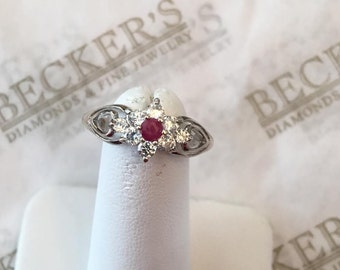 Vintage sterling silver ring, center Round Ruby and 8 Clear CZs in cluster halo, size 7.25