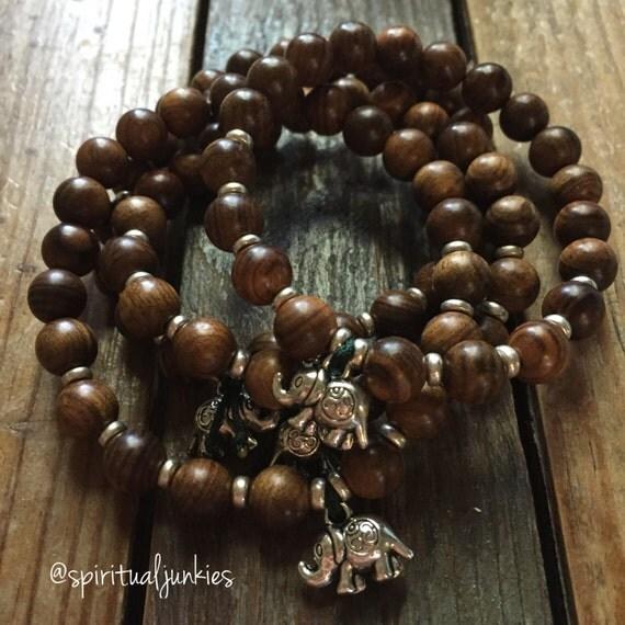 Stackable Mala Inspired Natural Agarwood Yoga and Meditation Bracelet with Om Elephant Charm (single bracelet)