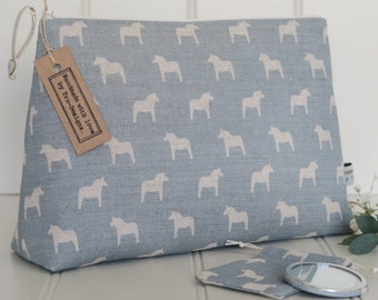 Large make up or wash bag in Olive & Daisy, Swedish Horses in Powder Blue Blotch Linen.