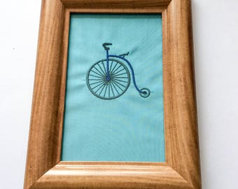 Framed embroidered penny farthing