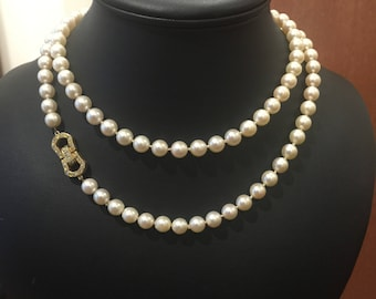Opera length pearl necklace with gold and diamond buckle