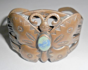 Beautiful vintage Southwestern style copper butterfly cuff bracelet with stampwork and blue green stone