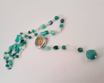 Long turquoise necklace with clock as pendant!