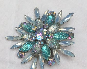 Gorgeous starburst brooch in opaque blues and turquoise