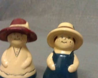 Dutch Looking Couple with Beige Maroon and Blue Clothes Salt and Pepper Shaker Set