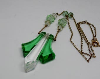 Vintage French Original Art Deco Rolled Gold Clear & Green Cut Crystal Glass Pendant Necklace  In The Shape of A Stylized Fleur De Lis