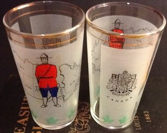 Very Vintage Set of 2 Canada Provinces and Mountie Souvenir Glasses Frosted with Maple Leaf Border
