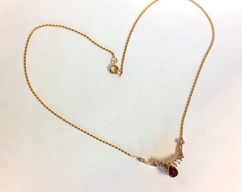 high karat gold ruby and diamond necklace