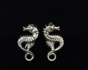 Vintage screwback sterling silver seahorse earrings.