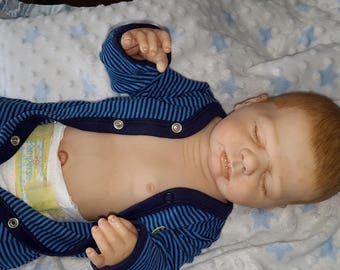 Anatomically correct, Reborn baby boy doll. Has full body. Made from the Harper kit.