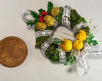 Miniature Christmas wreath with fruits is handmade dollhouse decoration