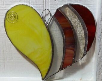 Yellow/swirls of orange/clear stained glass heart sun catcher