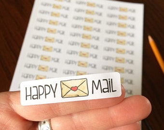 "Stickers ""Happy mail"" with a little envelope, on white paper"