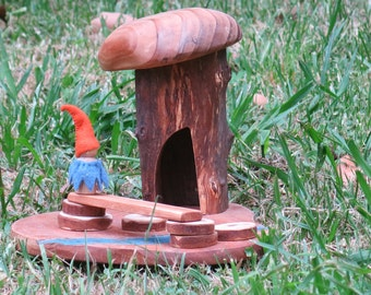 Wood Carved gnome house with a river for imagination play or garden feature