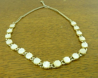 Vintage goldtone  necklaces with mother of pearl round discs