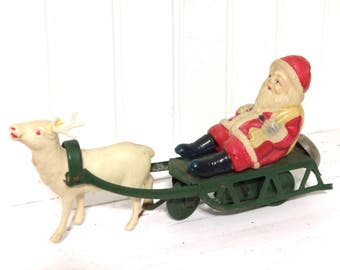 Vintage Celluloid Santa on Sleigh Wind Up Toy
