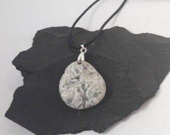 Pendant carved stone