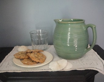 Vintage green pottery pitcher needs a home