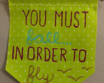 Motivational Banner- 'You must fall in order to fly'