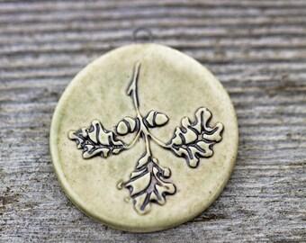 Oak leaves and acorn round porcelain pendant|Iron wash light olive green glaze
