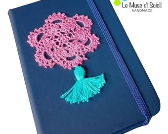 Blue notebook with pink and turquoise crochet decoration
