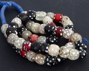 "v17-  55  round white, black and red fancy ""eyes"" beads"