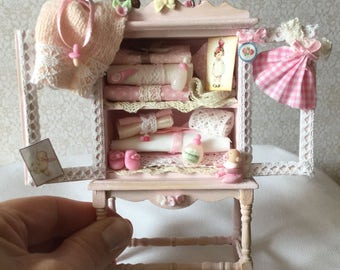 Wardrobe for baby room decorated in pink