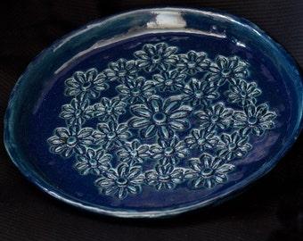 Ceramic decorative floral plate in dark blue glaze