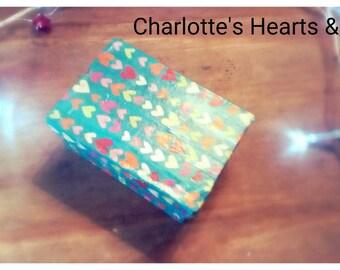 Hand made decoupaged cardboard gift/trinket box. Aqua blue with tiny coloured hearts.