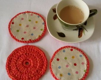 Orange coasters with spotty linen lining