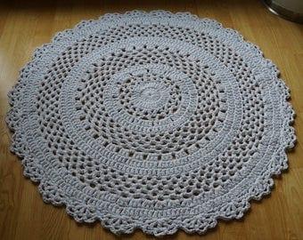 White or light yellow crocheted round rug