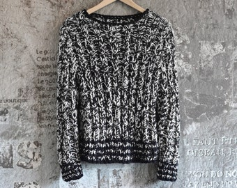 coarsely knitted black and white wool sweater from thick Merino Wool