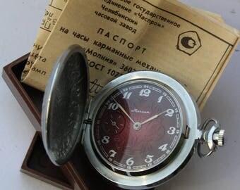 New Soviet pocket watch. Vinous dial. Vintage mechanical pocket watch USSR. MOLNIJA.