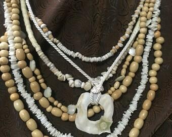 Ocean inspired off white multi-strand seashell necklace.