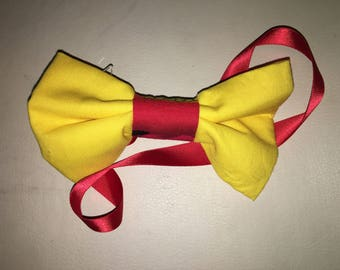 Yellow bow tie with red lining