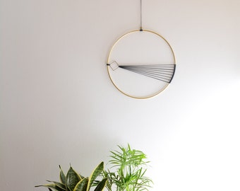 Elegant and modern brass wall hanging