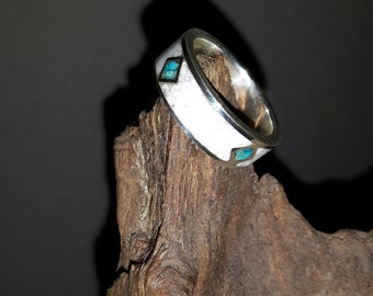 Silver ring inlaid with natural stone