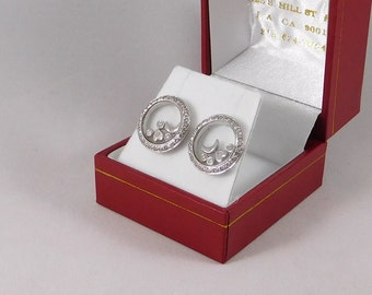Floating Diamond Earrings. 0.50 Carats in an 18k White Gold Setting