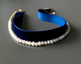 Velvet Choker with a pearl necklace.