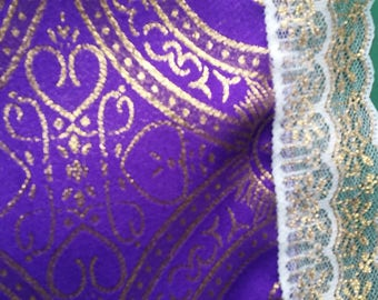 Purple with mettallic gold higlights, and metalic trim