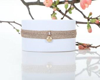 Phecda - Shell rose gold woven bracelet