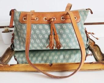 Vintage Dooney & Bourke Logo Fabric Tan Brown All Weather Leather Tassel Shoulder Bag Purse Tote Shopper