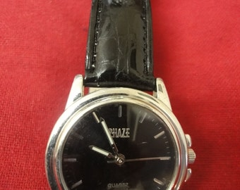 Gents designer watch by PHAZE in new condition with black leather strap