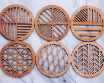 Laser cut modern geometric coasters light birch stain
