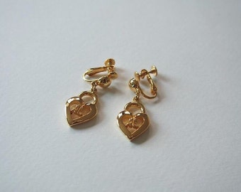 Authentic COURREGES logo locked heart clip on gold tone earrings