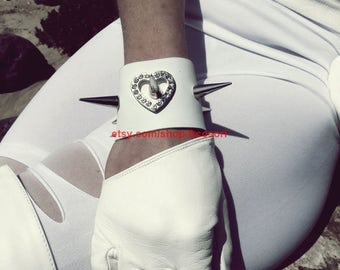 spiked white leather cuffs with rhinestones and spikes