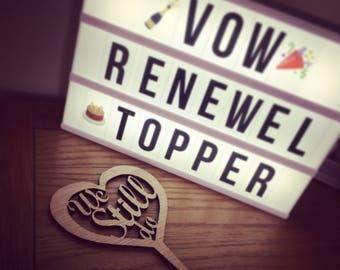 We still do cake topper / wedding vow renewal
