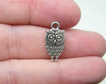 8 Silver Tone Owl Charms. B-007